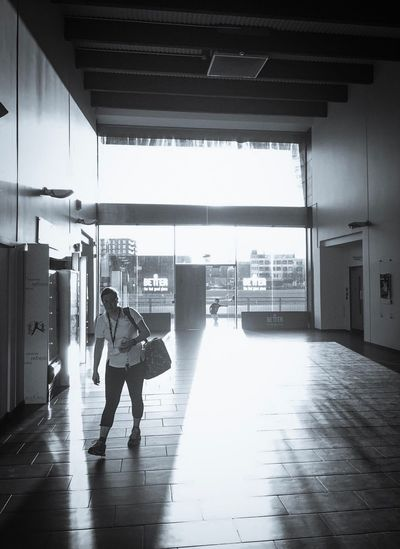 Full Length One Person Built Structure Architecture Indoors  Airport Day One Woman Only People Only Women Adults Only Adult Leisure Activity Silhouette London Blackandwhite Blackandwhite Photography IPhoneography Foyer Shadows & Lights Sun Sunlight Glare Sports Photography Sports Center