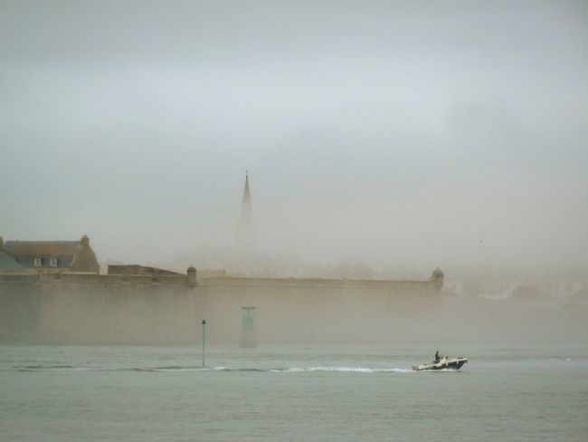 Port Louis in the mist. Port Louis Port-louis Lorient Fort France Brittany Water Nautical Vessel Waterfront Boat Sea Dusk Tranquil Scene Tranquility Calm Scenics Ocean Sky Nature Church Spire  From My Point Of View Check This Out France Photos Silence