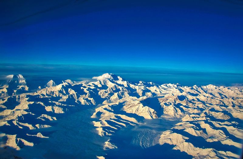 Denali from the air Highest Peak In North America Snow Covered Landscape Mountain Range Blue Beauty In Nature Scenics - Nature Sky Tranquility Tranquil Scene Nature Clear Sky Idyllic Land No People Copy Space Horizon Day Sunlight Outdoors Cold Temperature Winter Landscape Travel Destinations