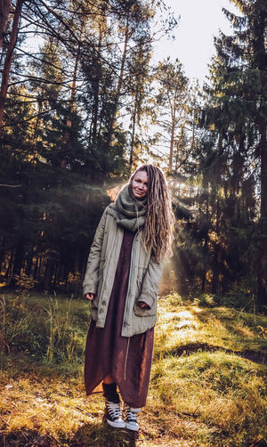Young woman with dreadlocks in autumn fall forest in the morning sunshine Fall Fall Forest Autumn colors Autumn Collection Dreadslocks Dreadhead Outdoors Nature Forest Tree Boho Happiness Boho Style Moments Of Happiness