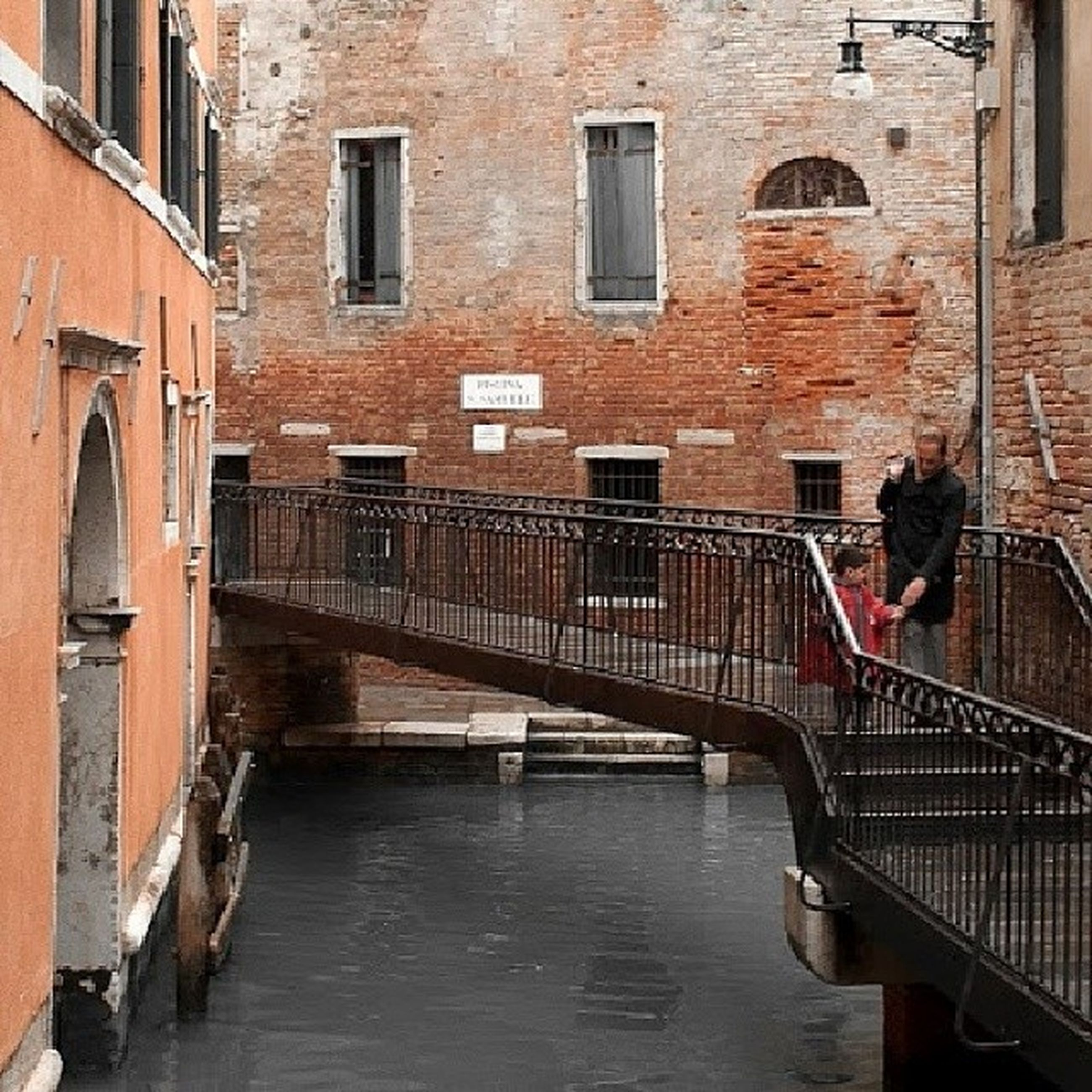 architecture, built structure, building exterior, men, canal, building, lifestyles, water, person, window, walking, leisure activity, steps, city, full length, arch, transportation, railing