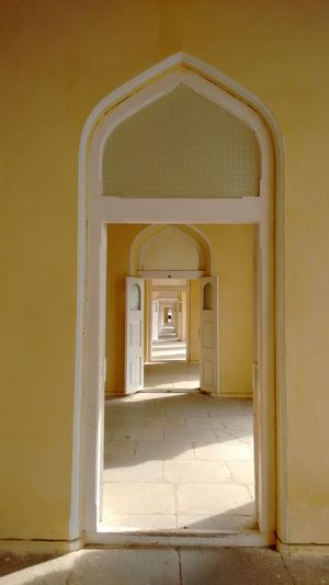 Walk through a door,then second one,then next one.... Infinity Old Architecture The Doors Urban Geometry Yellow Hyderabad Monuments Hyderabad,India Hyderabad Heritage ChowmahallaPalace Mughal Architecture