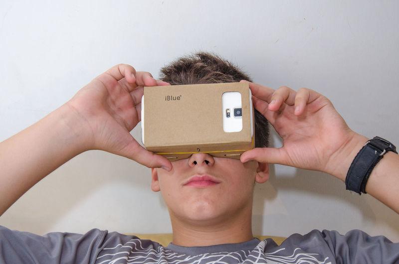 Close-up of boy wearing virtual reality simulator