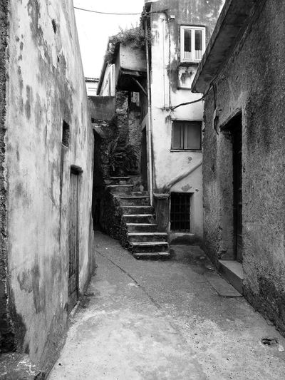 Glimpse of the historic center Black & White Historic Center Italia Old Town South Italy Stairs Abandoned Architecture Black And White Black And White Photography Building Exterior Built Structure Calabria Glimpse House No People Outdoors Residential Building Steps Street Travel Destination Verbicaro Window