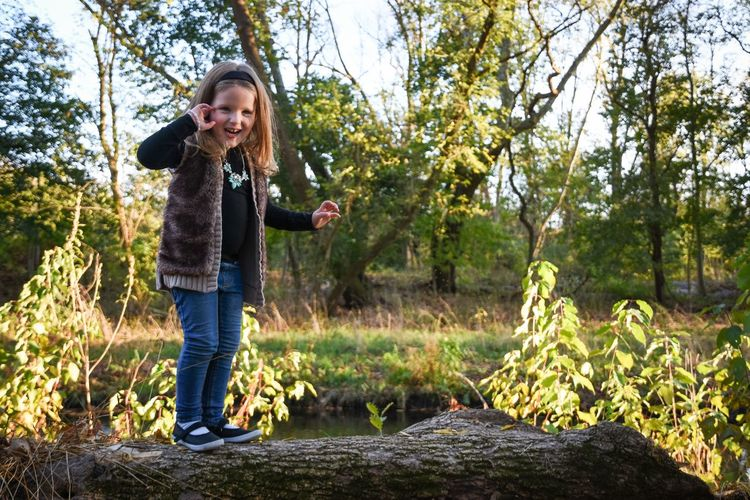 Lilah. Portrait One Person Nature Jeans Leisure Activity Girls People Young Women One Woman Only Tree Smiling Outdoors Only Women Women Portraits Photoshoot Photography Pennsylvania Person People In Places People And Places Girl Log Fun Playing