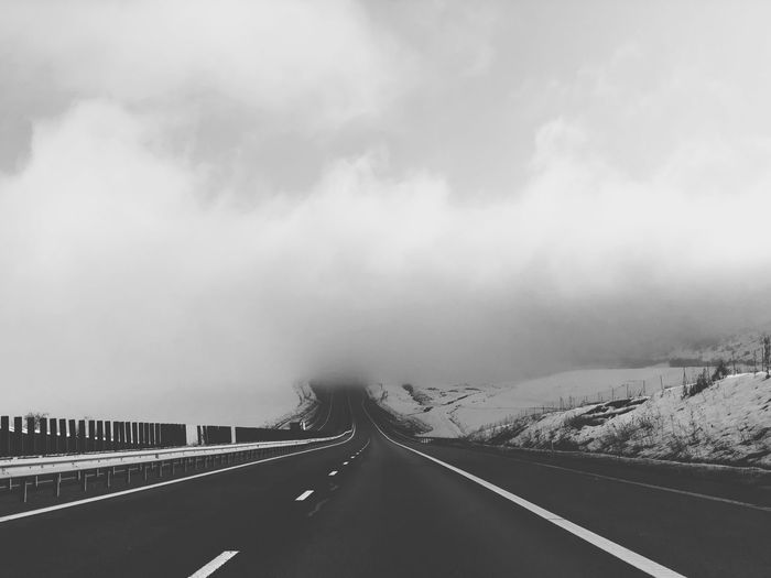 Into the wild Wild Transportation Road Concept Road Foggy Morning Foggy Fog Road Transportation Cloud - Sky Sky The Way Forward Direction Symbol Marking No People Day Diminishing Perspective Fog Beauty In Nature vanishing point Car Sign Road Marking Nature Outdoors Dividing Line