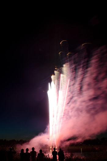 Fireworks in Finland Atmosphere Atmosphere Atmospheric Mood Dark Finland Firework Fireworks Fireworksphotography Illuminated Järvenpää Lake Motion Night Nightphotography People Real People Silhouette Silhouettes Silhouettes Of People Smoke