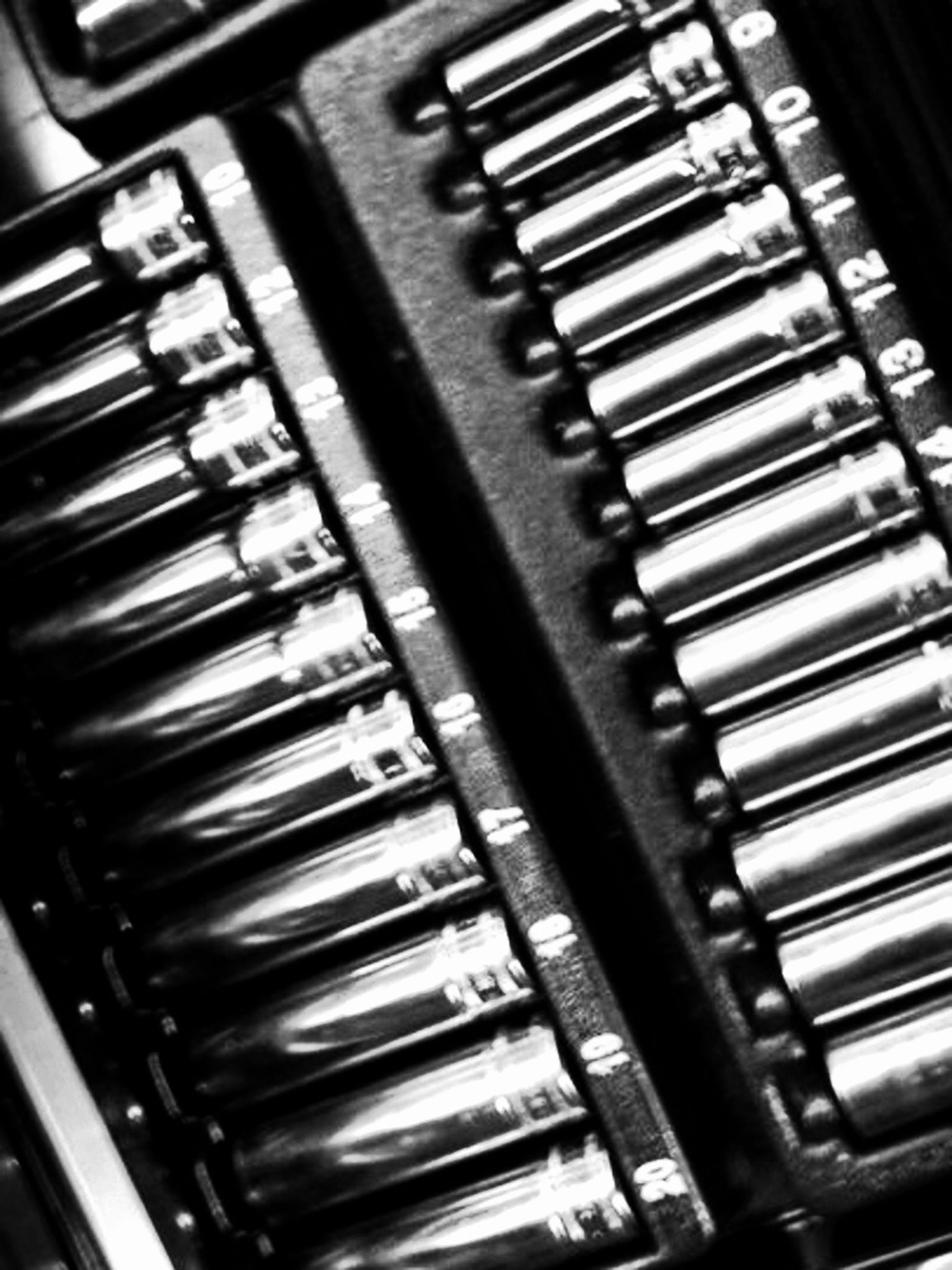 indoors, close-up, technology, in a row, full frame, backgrounds, repetition, metal, no people, high angle view, pattern, still life, order, large group of objects, music, piano key, arts culture and entertainment, metallic, detail, selective focus