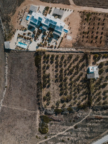 Aerial photo of a villa and pool in Greece Architecture Building Exterior Built Structure Building No People Water Nature Day Technology Outdoors Transportation High Angle View City Travel Destinations Travel Road Communication House Aerial View Digital Composite Mediterranean