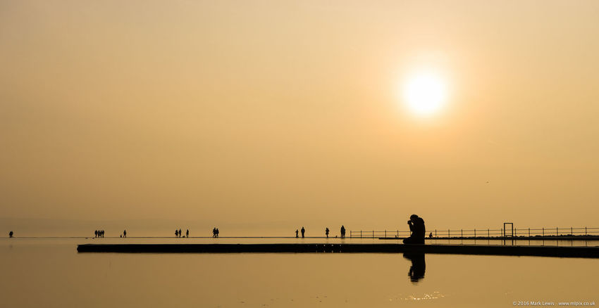 Clear Sky Leisure Activity Lifestyles Orange Color Person Photography Photogrpher Railing Reflection Sea Silhouette Sun Sunset Walking Water
