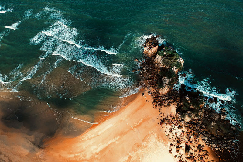 Water Sea Beauty In Nature Rock High Angle View Nature Rock - Object Motion Wave Solid Land No People Day Scenics - Nature Sport Beach Outdoors Rock Formation Power In Nature Breaking