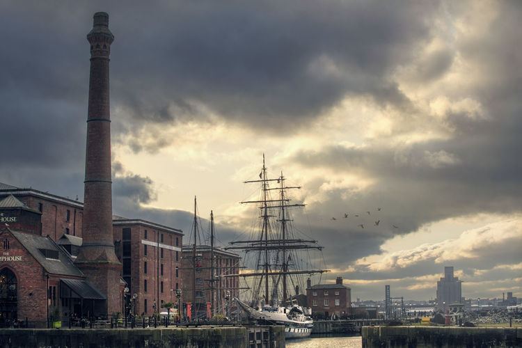 Liverpool harbor Architecture Building Exterior Built Structure Cloud - Sky Sky Smoke Stack Factory Industry No People Nature City Water Environmental Issues Tall - High Nautical Vessel Industrial Building  Pollution Building Day Transportation Outdoors Industrial District Air Pollution Ship Harbor Liverpool Flying Birds Sunset Moody Sky Old Ship Brick Building Red Brick Boat Chimney