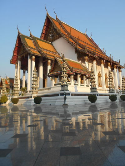 Wat Suthat Architecture Building Exterior Built Structure Clear Sky Day History No People Outdoors Place Of Worship Religion Sky Spirituality Temple Architecture Travel Destinations