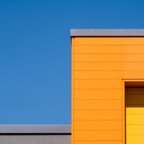Abstractarchitecture Abstract Architectural Detail Architectural Feature Architecture Berlinmalism Blue Building Building Exterior Built Structure Clear Sky Copy Space Fujix_berlin Minimal Minimalism No People Orange Color Outdoors Pattern Ralfpollack_fotografie Wall - Building Feature Yellow The Architect - 2018 EyeEm Awards