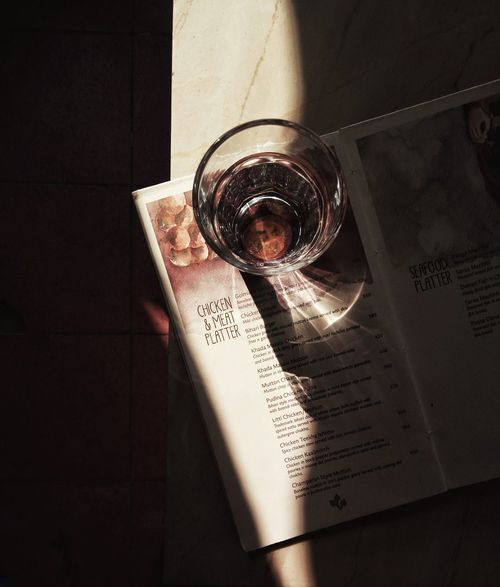 The Still Life Photographer - 2018 EyeEm Awards Book Close-up Communication Container Directly Above Drink Drinking Glass Food And Drink Glass High Angle View Household Equipment Indoors  Menu No People Paper Publication Refreshment Still Life Table Text Western Script