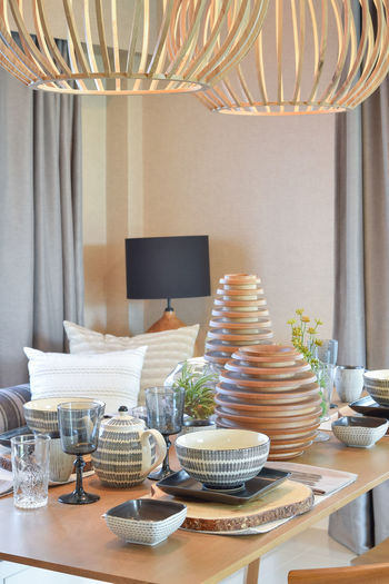 Ceterpieces and eating utensils on dining table at home