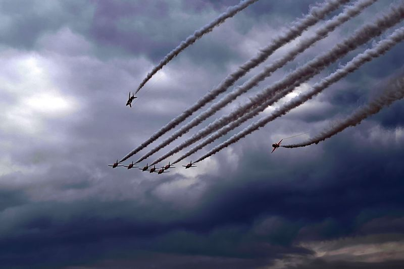 The RAF Ref Red Arrows display team performing on a stormy day Raf Redarrows Aircraft Jets Flying Airdisplay