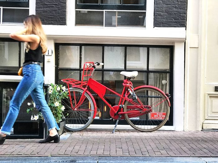 Red bike in the Negenstraatjes, Amsterdam Red Bike Cycling Amsterdam Europe Trip Dutch Culture Holland Netherlands Transportation Architecture Bicycle Building Exterior Mode Of Transportation Land Vehicle Built Structure City Real People Casual Clothing One Person Women Leisure Activity Window Stationary Lifestyles Street
