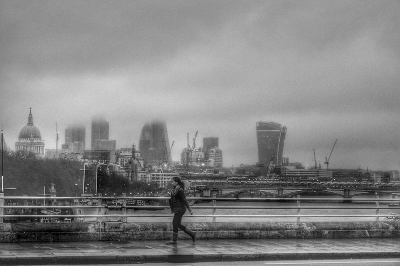 Misty London Bridge. Architecture Built Structure Building Exterior Sky Real People Water City Outdoors River Riverbank Men Skyscraper Day Travel Destinations Modern Women Full Length One Person Urban Skyline Cityscape London Waterloo Bridge River Thames Bank Thames River