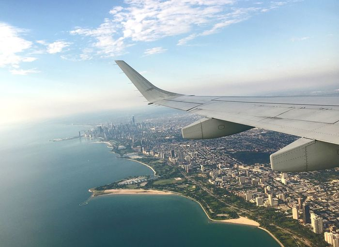 Flying over Chicago Airplane Wing Lake Michigan Downtown Lake View Great Lakes Lakeview Views View Travel Travel Destinations EyeEmNewHere Chicago Air Vehicle Airplane Sky Transportation Flying Aerial View Water Nature Cloud - Sky Mode Of Transportation Aircraft Wing Cityscape Building Exterior