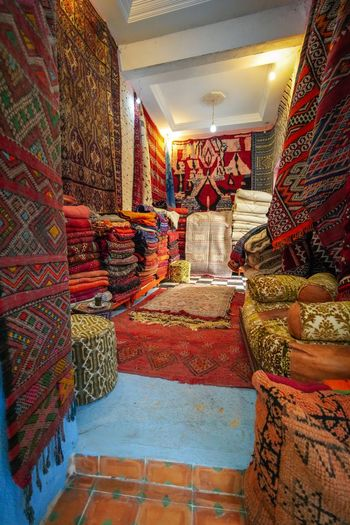 Carpet run EyeEmNewHere Digital Nomad Travel Destinations Travel Photography Morroco Fes Morocco Multi Colored For Sale Indoors  Variation Choice Retail  Textile Large Group Of Objects No People Illuminated Pattern Store Architecture Business Carpet - Decor Decoration Lighting Equipment Art And Craft Arrangement Abundance Retail Display Floral Pattern