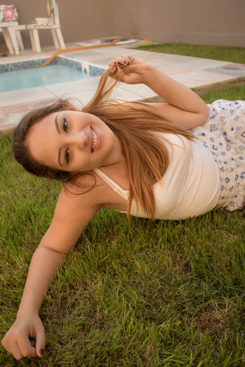 Beautiful Woman Close-up Cute Day Grass Happiness Leisure Activity Lifestyles Looking At Camera Lying Down One Person Outdoors Portrait Real People Sexygirl Smiling Young Adult Young Women
