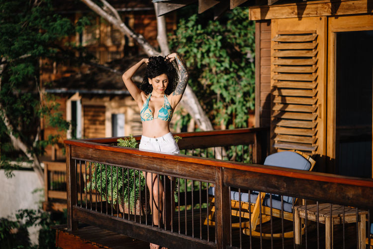 Woman on hotel balcony