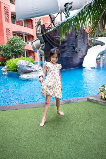 Full length of girl on swimming pool