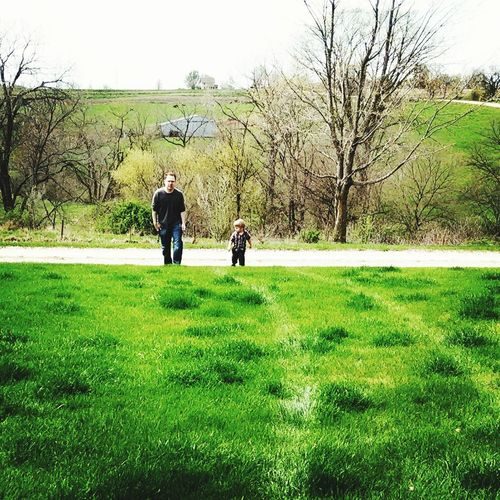 Father and son Farm Father And Son Grass Father Togetherness Bare Tree Walking Green Color Field Family With One Child Family Leisure Activity Tree Child Men Day Nature Bonding Growth Full Length