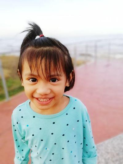 Portrait of smiling innocent girl