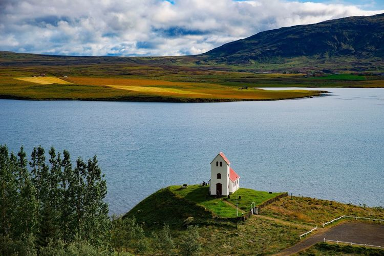 Church at a Lake in Iceland. Travel Lake Church Church Buildings Iceland EyeEm Best Shots Beauty In Nature Two People Mountain Scenics - Nature Water Sky Cloud - Sky Green Color Outdoors Tranquility Togetherness Real People Tranquil Scene Nature