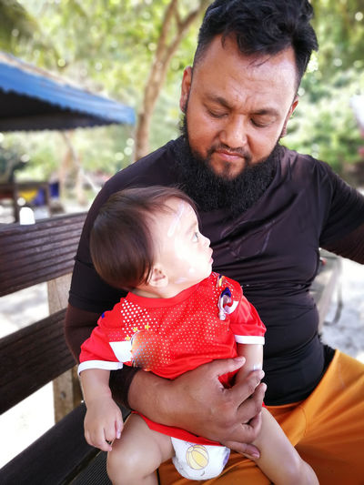 Pulau Redang, Terengganu, Malaysia. Family Child Childhood Parent Real People Males  Bonding Togetherness Men Family With One Child Adult Father Females Mid Adult Front View Baby Women Love Innocence Positive Emotion Son Daughter Care
