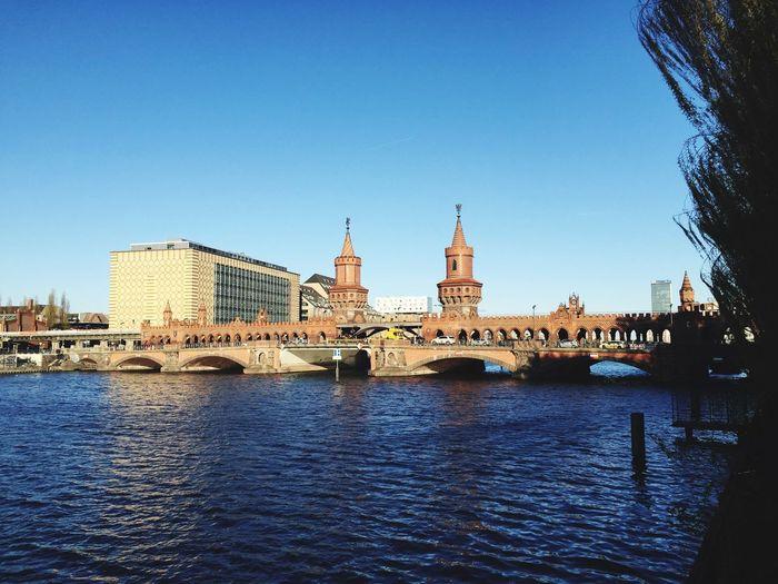 Oberbaum Bridge Over River Spree Against Clear Blue Sky