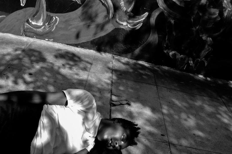 High angle view of woman dancing on glass