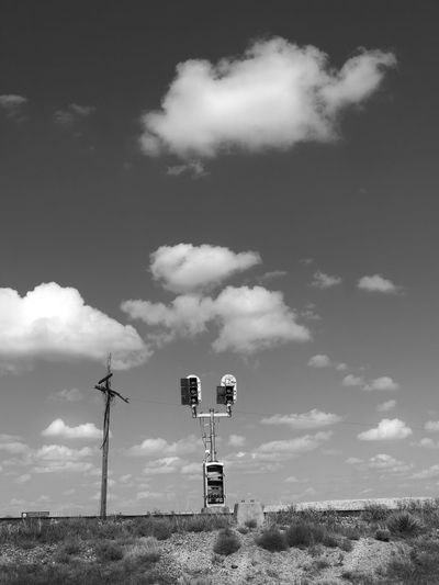 Surrendered Black And White Cloud Cloud - Sky Desert Scrob Dramatic Sky Journey Lonely Low Angle View No People Outdoors Railroad Railroad Switch Boxes Railroad Track Sky Telegraph Telegraph Pole