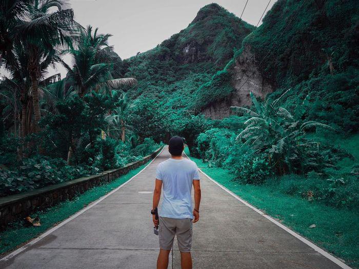 Rear view of man walking on mountain