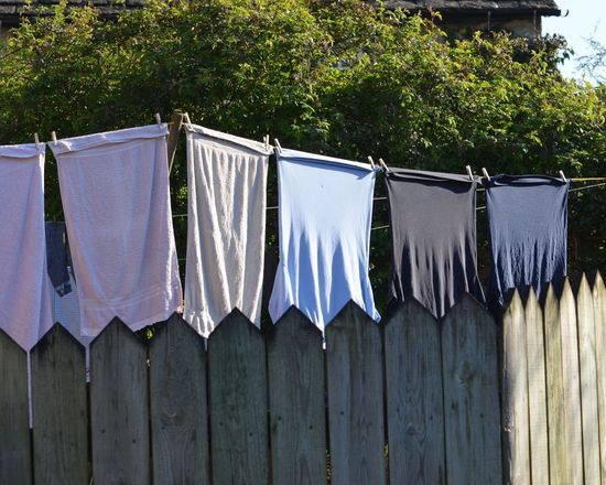 Chores Clothesline Clothing Drying Fence Housework Laundry Muted Colors No People Outdoors Sunny Day