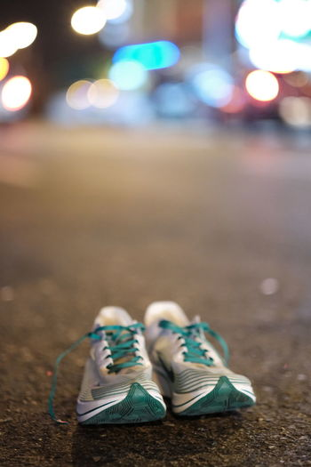 Close-up of shoes on road