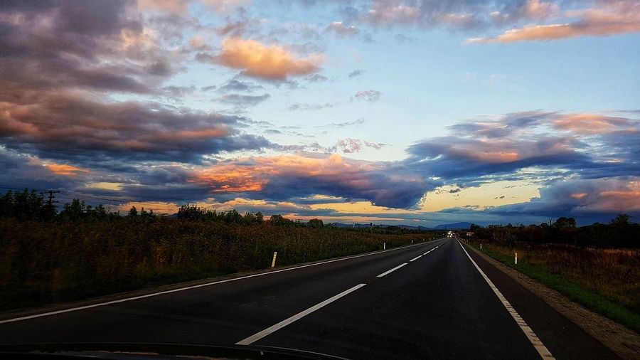on the road, along a beautiful sky EyeEmNewHere Sunset Romania Sky WOW Ontheroad Driving Breathtaking Space Mountain Multi Colored Road Rural Scene Journey Dramatic Sky Sun Romantic Sky Driver