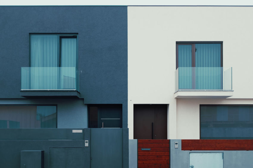 DIFFERENT TASTES IN THE NEIGHBORHOOD Threeweeksgalicia Architecture Built Structure Building Exterior Day No People Wall - Building Feature Building Outdoors Window City Glass - Material Blue Residential District Modern Closed Side By Side Full Frame Wood - Material Geometric Shape White Color Turquoise Colored
