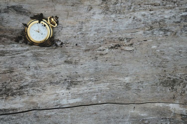 Close-Up Of Abandoned Clock On Plank