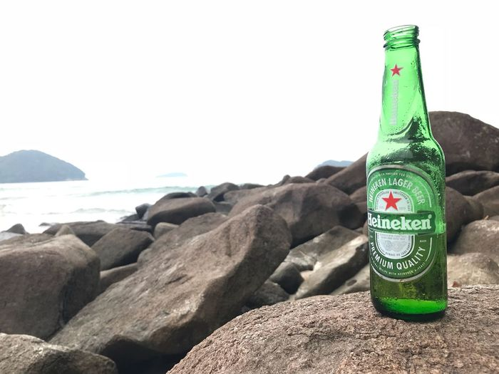 Heineken #Beer Beach Bottle Sea Green Color Water Day No People Outdoors Close-up Nature