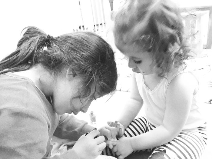 Indoors  Headshot Lifestyles Leisure Activity Person Friendship Casual Clothing Togetherness Sister Sisters Hands At Work Nailpolish Playing Children Role Model Privacy Sisterhood Holding