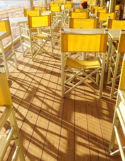 Empty yellow chairs in restaurant