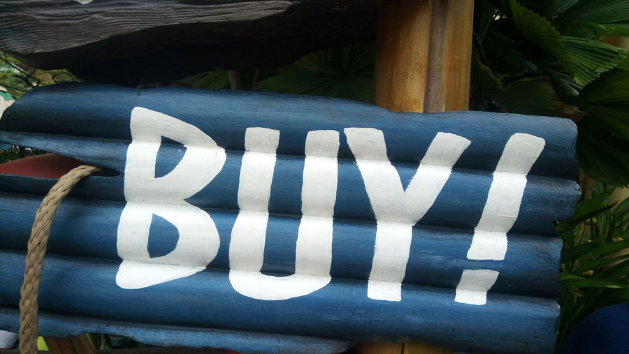 Buy sign on wooden structure