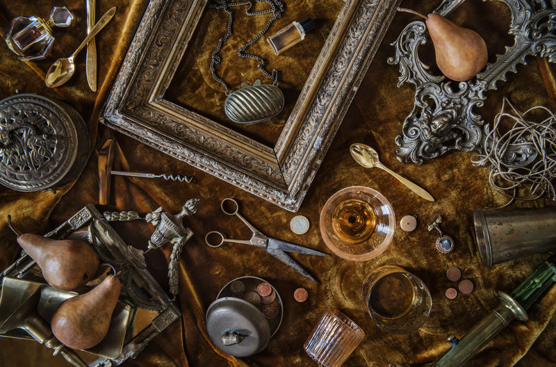 High angle view of old objects on table