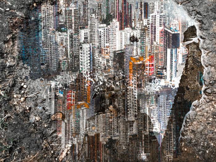 Digital composite image of modern buildings in city