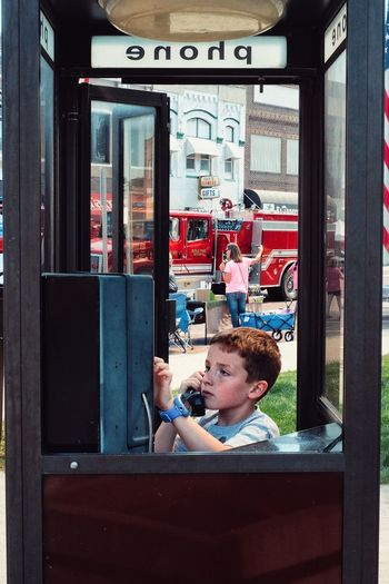 Boy using pay phone