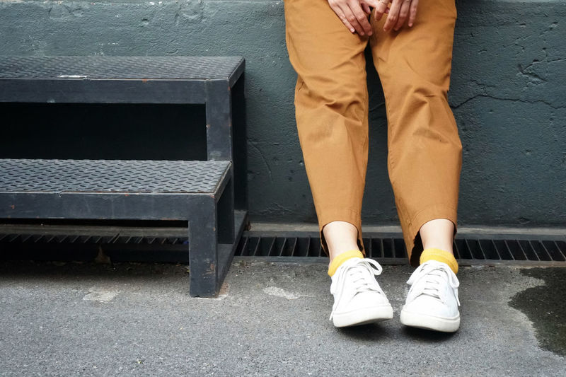 Low section of man sitting on bench