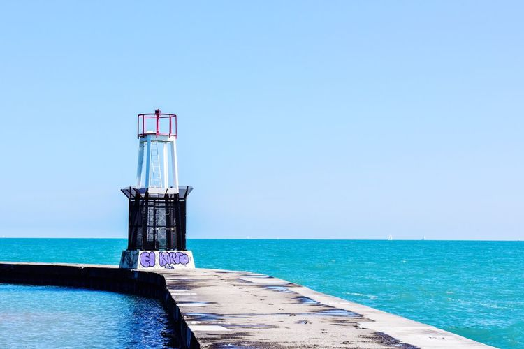 EyeEm Selects Great lake pier with buoy on Summer day Sea Horizon Over Water Water Blue Beach Sky Travel Destinations Vacations Day No People Outdoors Summer Clear Sky Nature Scenics Lighthouse Beauty In Nature Bradley Olson Bradleywarren Photography Vacation Sandy Beach Blue Sky Lake Michigan Blue Water